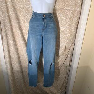 Women ripped jeans.